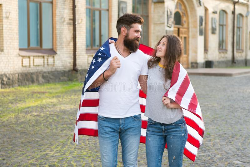 Visa applicants. Couple in love getting visa of united states. Bearded man and sensual woman wearing usa flag on stock photography