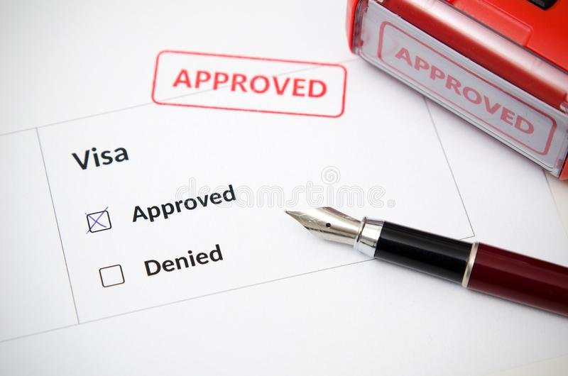 Visa and approved stamp on a document form stock image