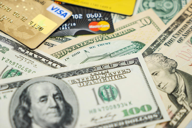 Visa and MasterCard credit cards and dollars royalty free stock photography