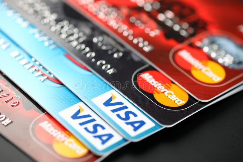 Visa and Mastercard. Tambov, Russian Federation - September 11, 2012 Visa and Mastercard logos on credit cards. Studio shot. Visa and Mastercard are a two royalty free stock photography