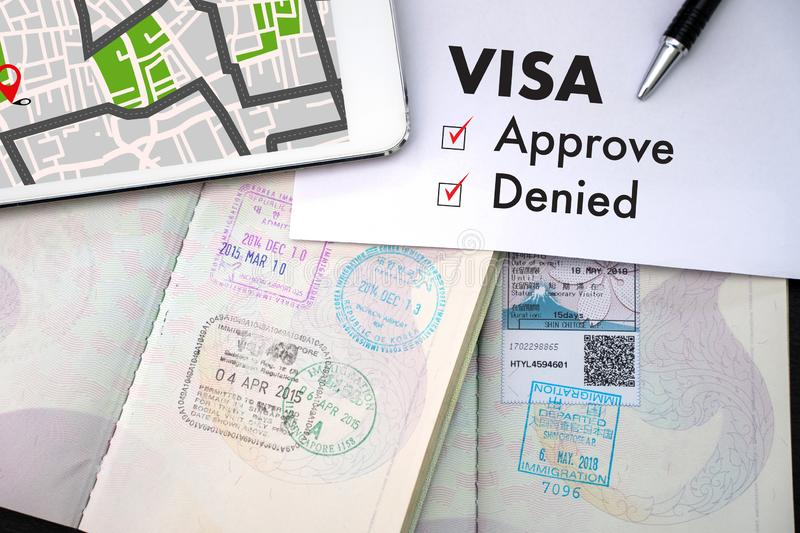 Visa and passport to approved stamped on a document top view in royalty free stock photos
