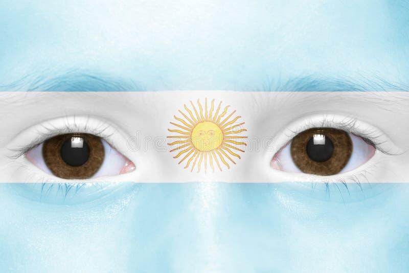 Visage avec le drapeau argentin images stock