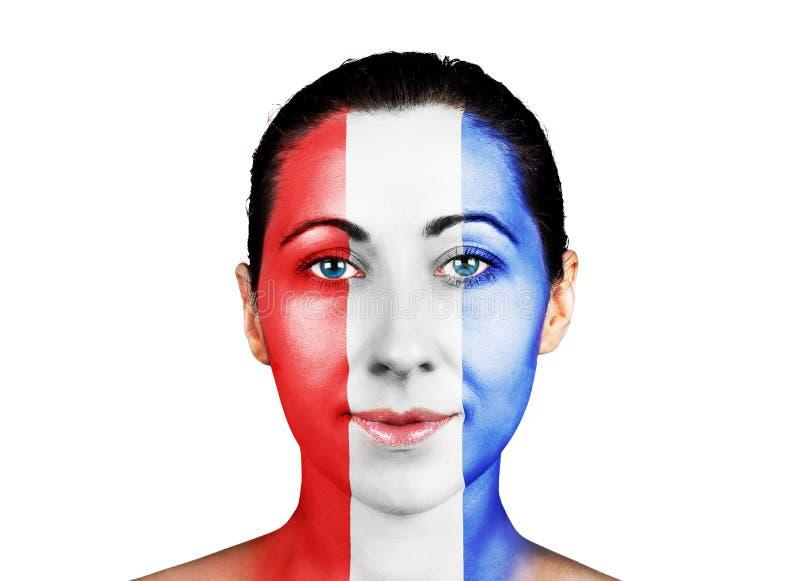 Visage avec le drapeau français photographie stock