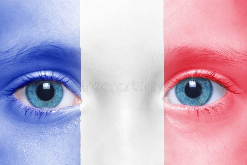visage avec le drapeau français image stock