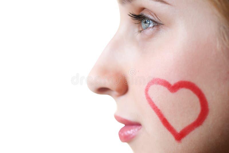 Visage avec un coeur photo stock