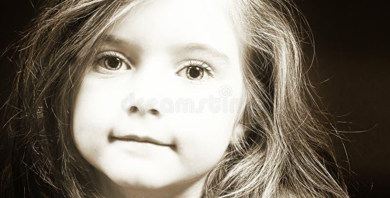 Visage blond de fille dans la sépia photo libre de droits