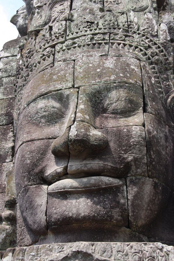 Visage d'idole. Temple de Bayon photo stock