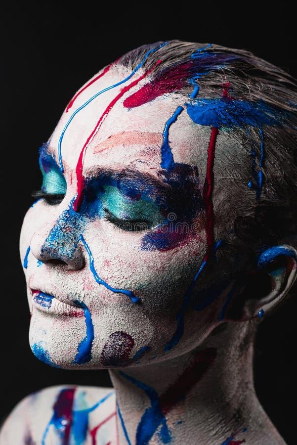 Visage de femme avec la peinture photos libres de droits