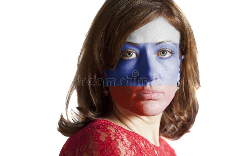 Visage de femme avec le drapeau russe peint photographie stock