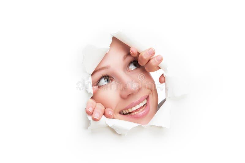 Visage de femme jetant un coup d 39 oeil par un trou d chir en affiche de livre blanc image stock - Telemoustique coup d oeil ...