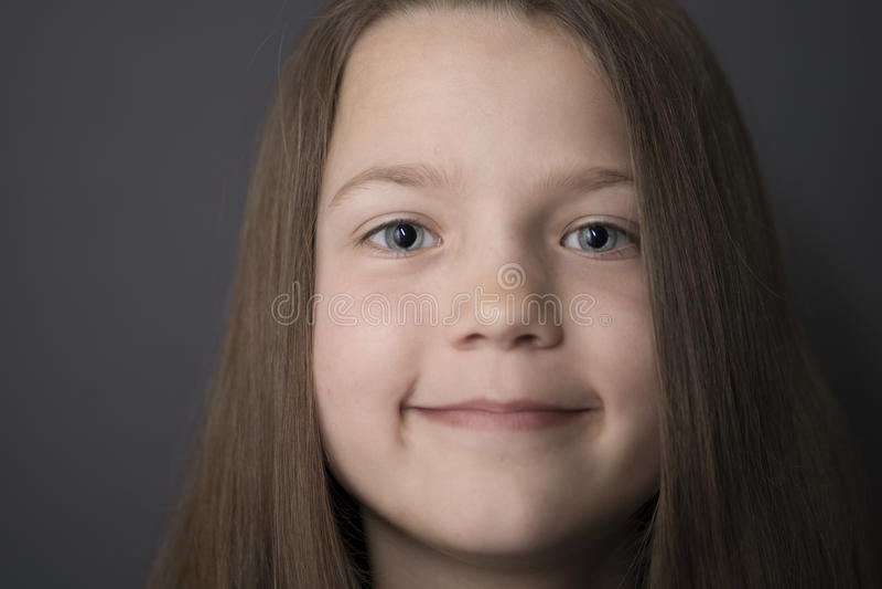 Visage de sourire de fille photo stock