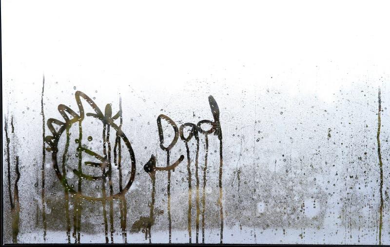 Visage dessiné dans la condensation photo libre de droits