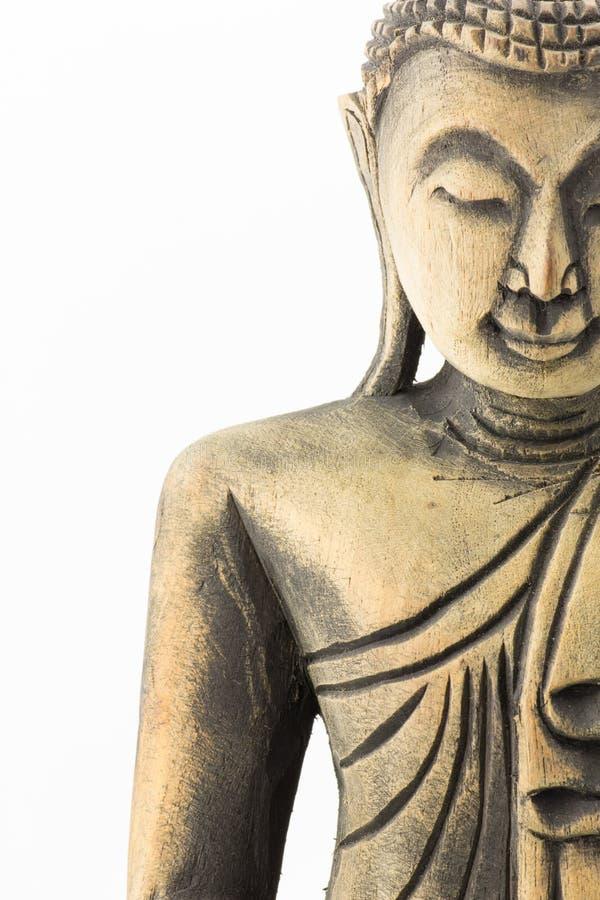 Visage du découpage en bois de Bouddha d'isolement sur le fond blanc photo stock