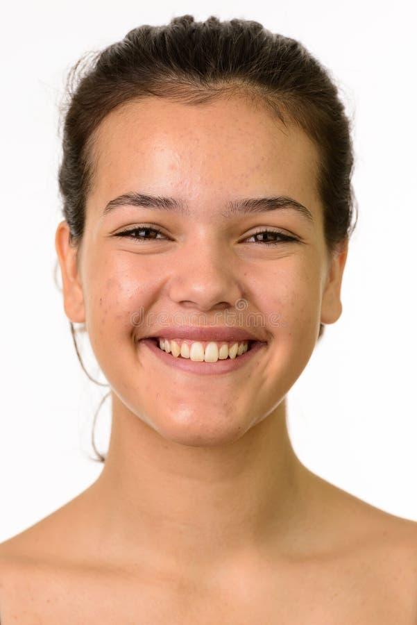 Visage du jeune sourire heureux d'adolescente photos stock