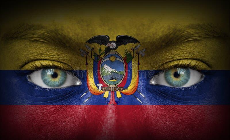 Visage humain peint avec le drapeau de l'Equateur photos libres de droits