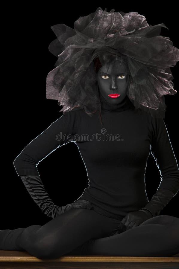 Visage peint par noir - Madame foncée image stock