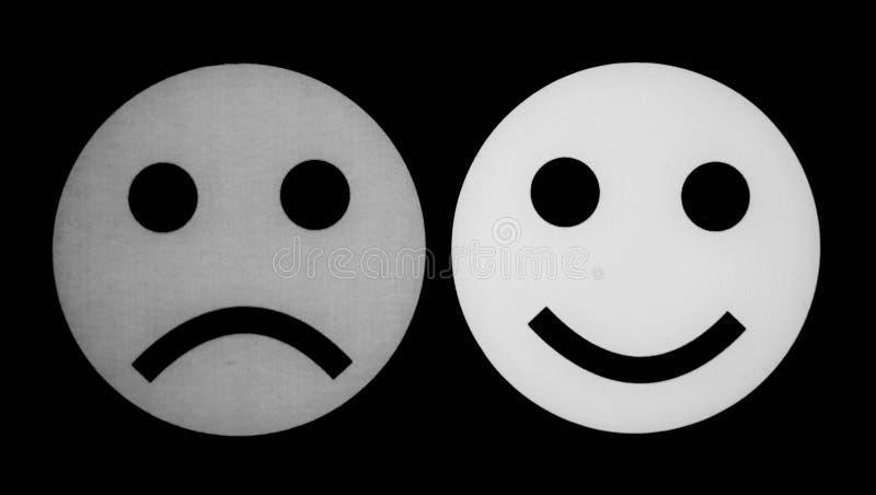 Visage souriant noir et blanc et visage triste photos libres de droits