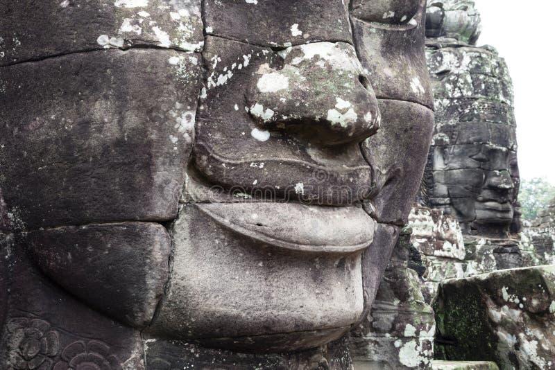 Visages en pierre au Cambodge photo stock
