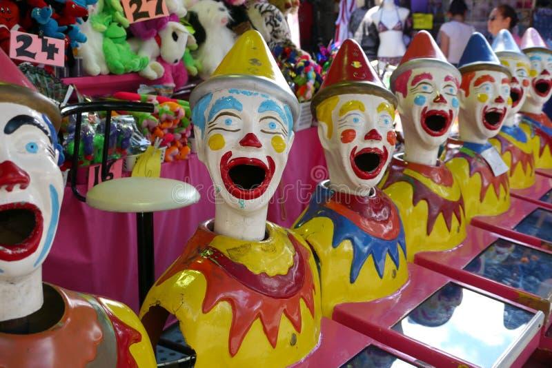 Visages mécaniques de clown de cirque images stock