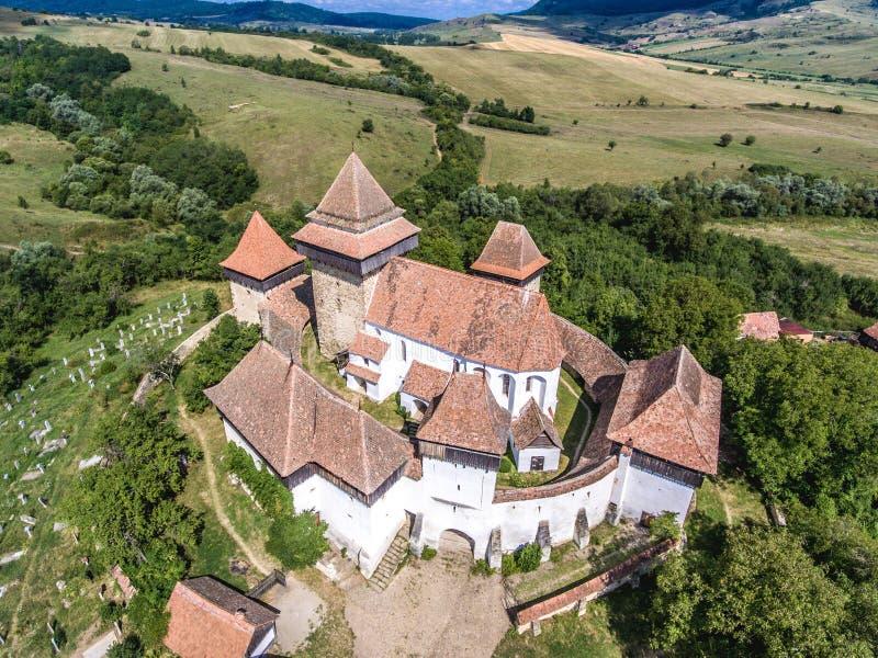 Viscri在特兰西瓦尼亚,罗马尼亚中间加强了教会 免版税图库摄影
