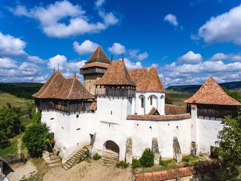 Viscri在特兰西瓦尼亚,罗马尼亚中间加强了Chruch 免版税图库摄影
