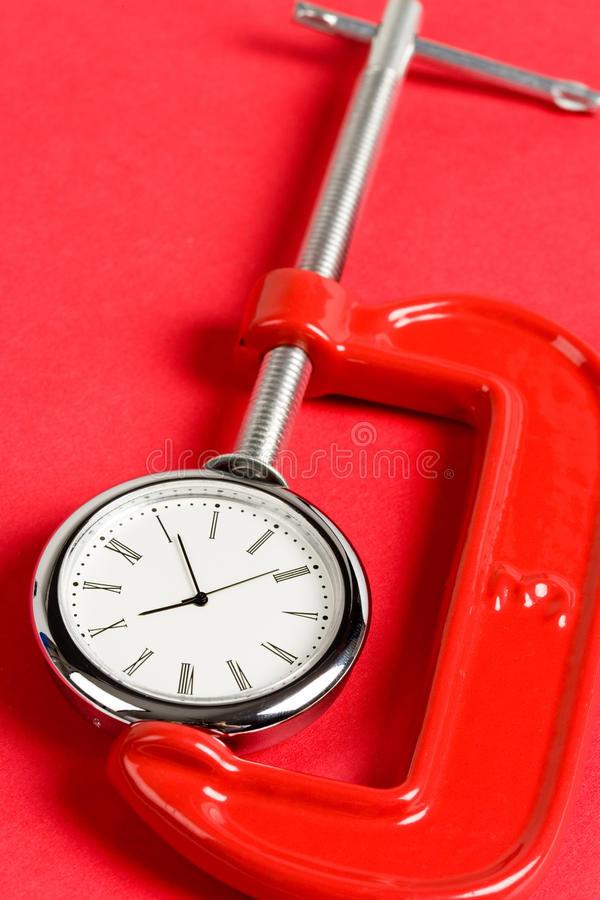Vise Grip And Clock Stock Photo