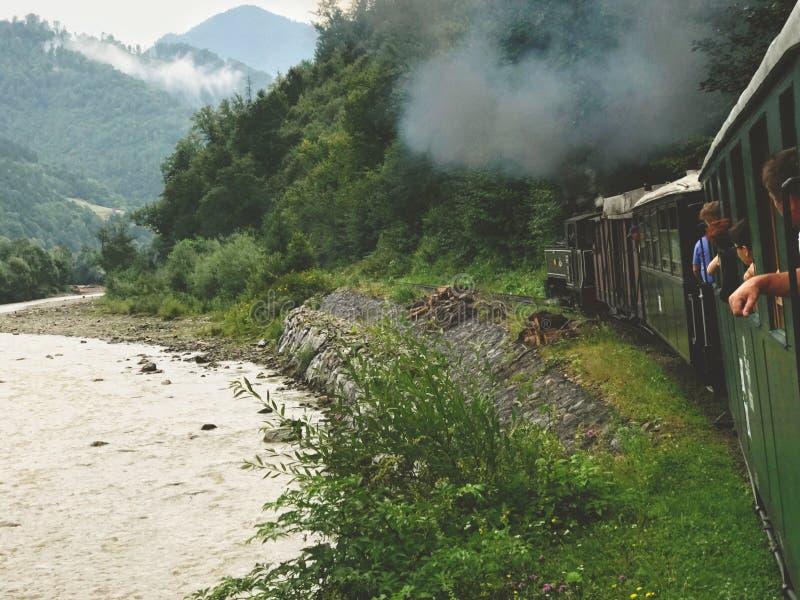 Viseu de Sus, Romania - August 6, 2017: Mocanita steam train going into the mountains of Maramures stock photo