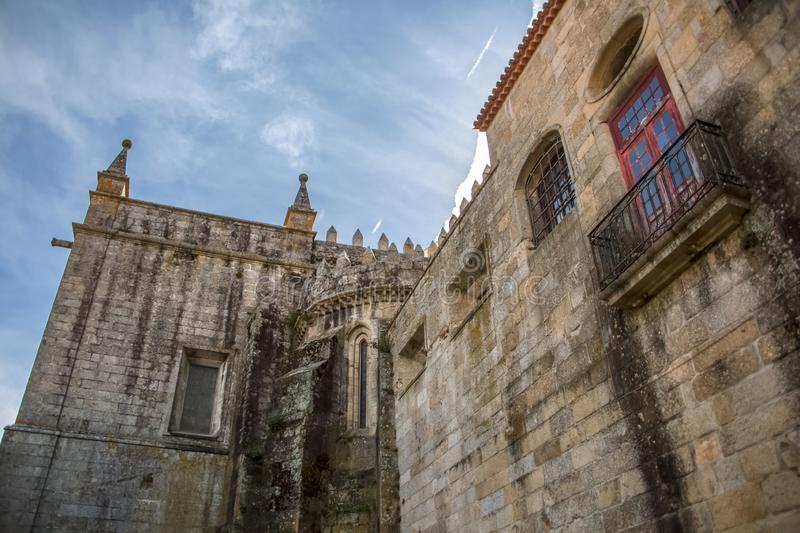 Viseu / Portugal - 04 16 2019 : Detailed view at the back facade of the Cathedral of Viseu, Se Cathedral de Viseu, architectural. Icon of the city of Viseu stock photography