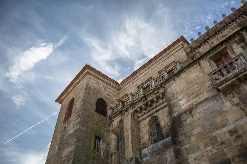 Viseu / Portugal - 04 16 2019 : Detailed view at the back facade of the Cathedral of Viseu, Se Cathedral de Viseu, architectural. Icon of the city of Viseu royalty free stock photography