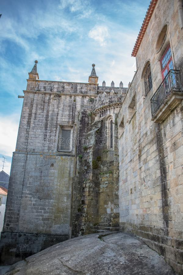 Viseu / Portugal - 04 16 2019 : Detailed view at the back facade of the Cathedral of Viseu, Se Cathedral de Viseu, architectural. Icon of the city of Viseu stock images