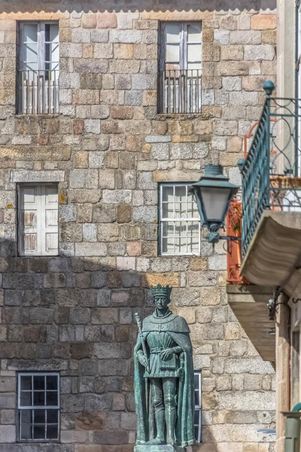 Detailed view at the lateral facade of the Cathedral of Viseu and D. Duarte statue. Viseu / Portugal - 04 16 2019 : Detailed view at the lateral facade of the royalty free stock images