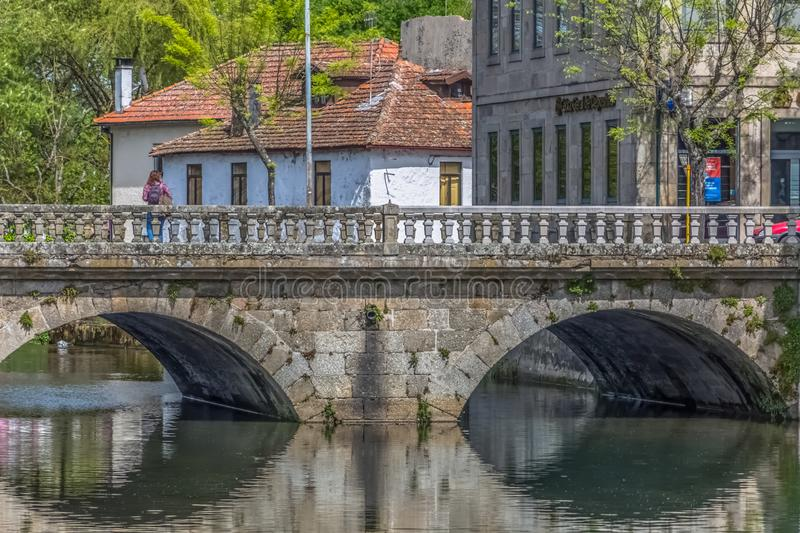 View of the downtown area of Viseu with Pavia river. Viseu / Portugal - 04 16 2019 : View of the downtown area of Viseu with Pavia river and banks with buildings stock images