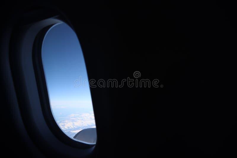Visión desde la porta del aeroplano imagen de archivo