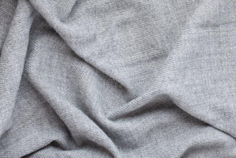 Visión superior sobre textura gris de lana suave del textil foto de archivo