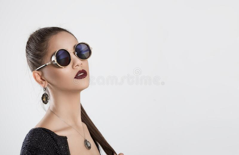 Vision. Closeup portrait beautiful woman holding eye glasses looking at you camera isolated white grey background wall. Ethnic stock images