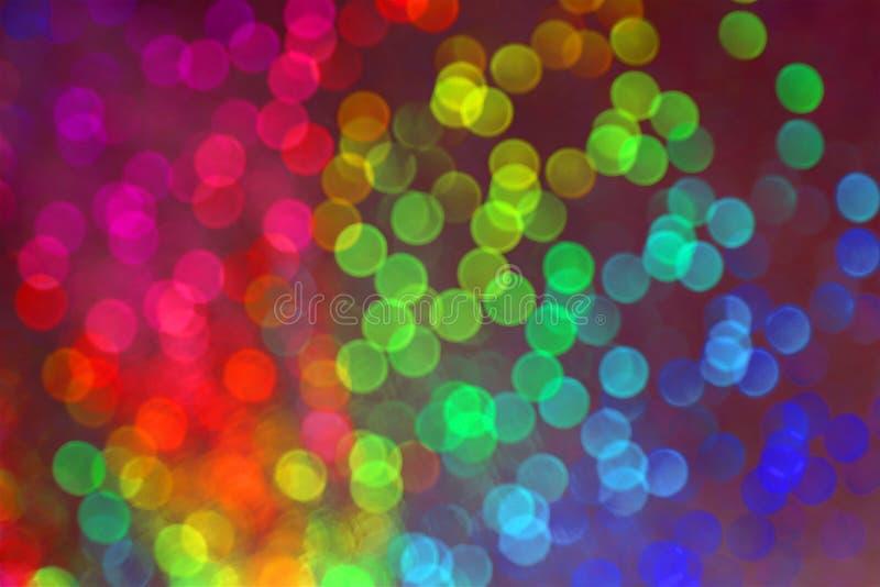 Vision de muchos puntos borrosos con el efecto del bokeh de muchos colores imagenes de archivo