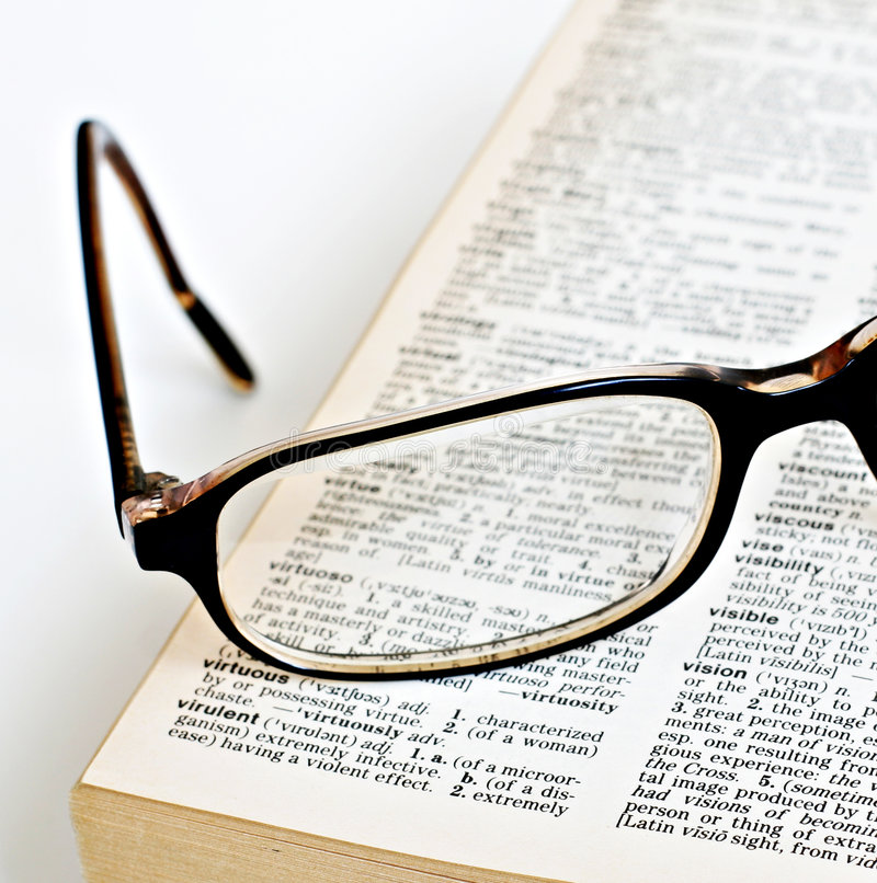 Vision glasses dictionary royalty free stock photo