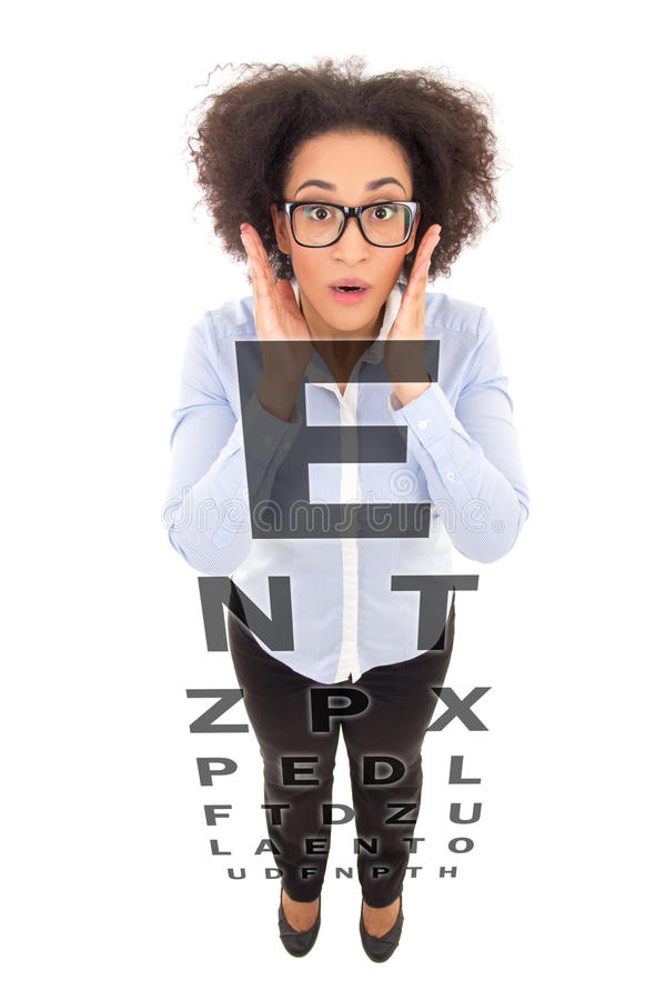 Vision problem concept - beautiful african american woman in eye royalty free stock images