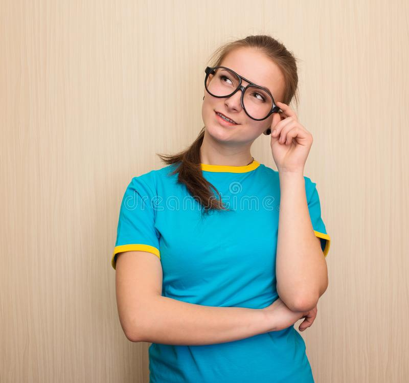Vision, school, education and people concept. Teen girl in blue t-shirt in eyeglasses royalty free stock photo