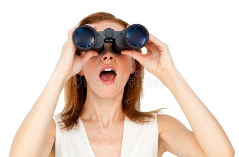 Visionary businesswoman looking through binoculars royalty free stock photos