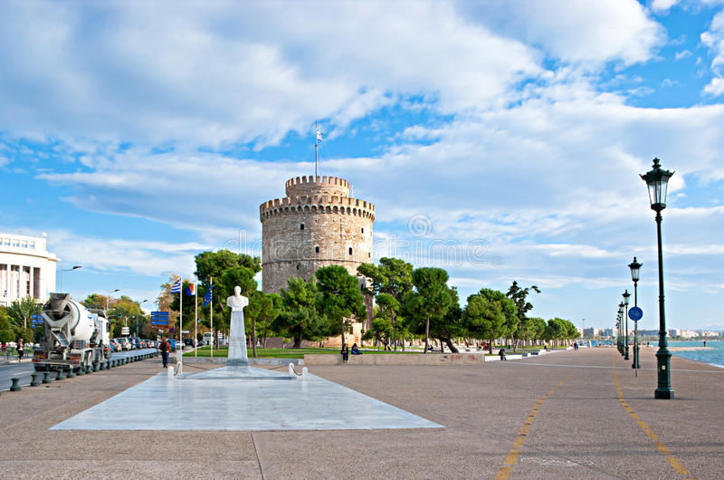 The visit card of Thessaloniki. THESSALONIKI, GREECE - OCTOBER 17, 2013: The White Tower and Admiral Votsis Statue locates on the sea promenade, on October 17 in stock photos