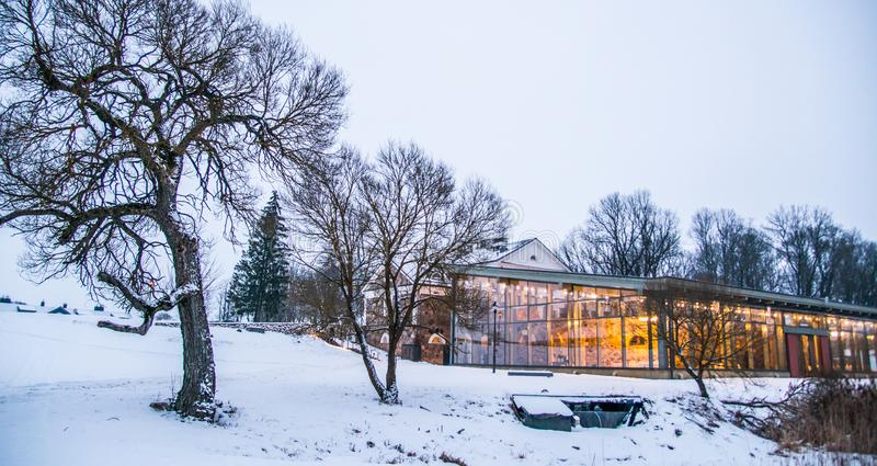 Visit Lithuania, manor house. Manor house Paliesiaus Dvaras near Ignalina in Lithuania, winter time royalty free stock photo