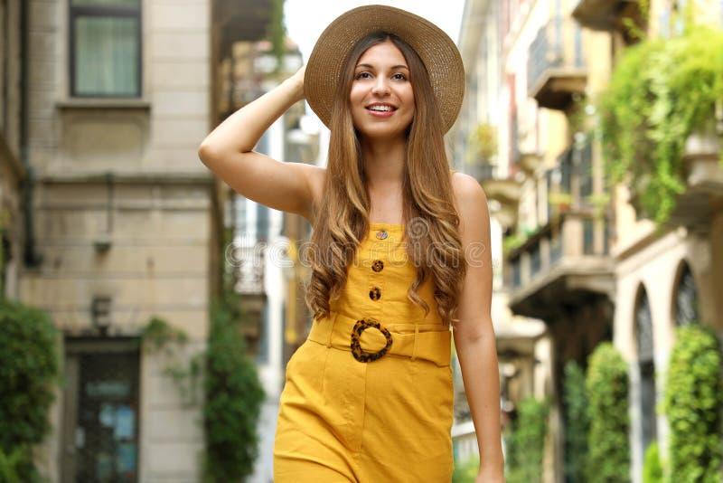 Visit Milan. Young fashion woman walking in city street of Brera neighborhood in Milan, Italy royalty free stock photos