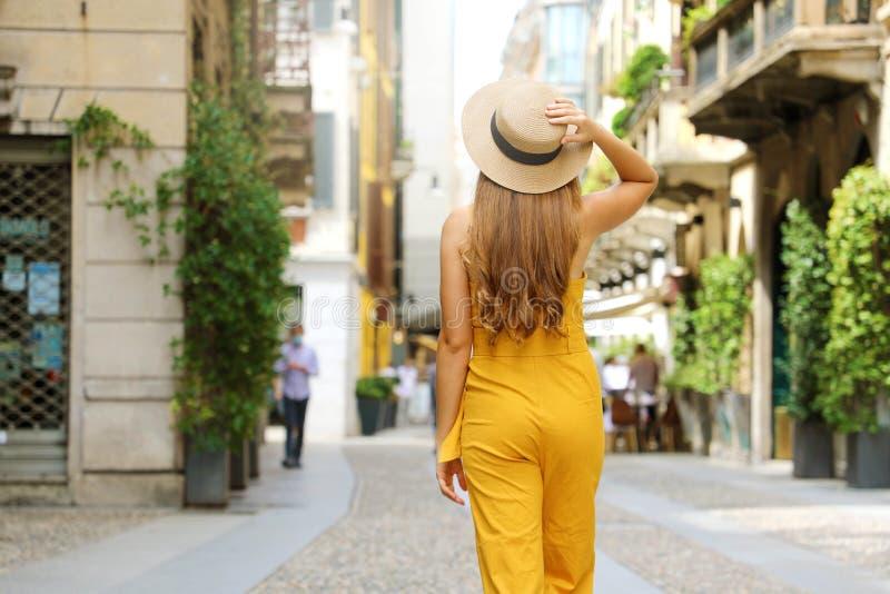 Visit Milan. Young fashion woman walking in city street of Brera neighborhood in Milan, Italy stock photo