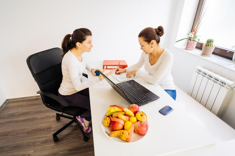 Visit to a nutritionist doctor stock photography