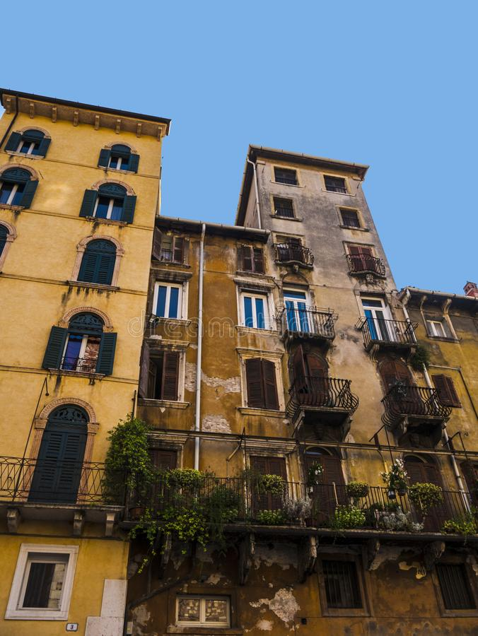 Building in the Piazza Erbe in the city of Verona in northern Italy. A visit to the opera in the Roman Amphitheatre in the city of Verona in Northern Italy is a stock images