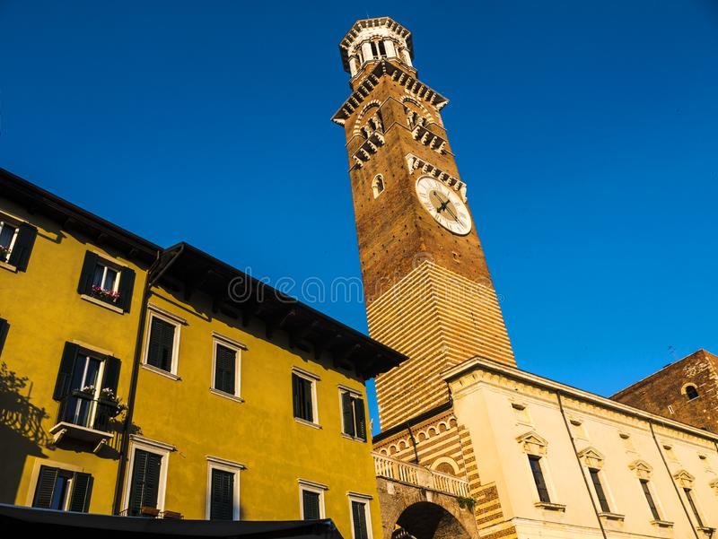Clock tower in the Piazza Erbe in the city of Verona in northern Italy. A visit to the opera in the Roman Amphitheatre in the city of Verona in Northern Italy is stock photos