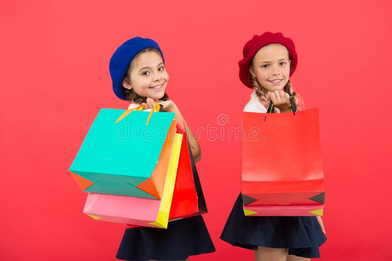 Visiting clothing mall. Discount and sale concept. Kids cute girls hold shopping bags. Shopping discount season. Special royalty free stock photography