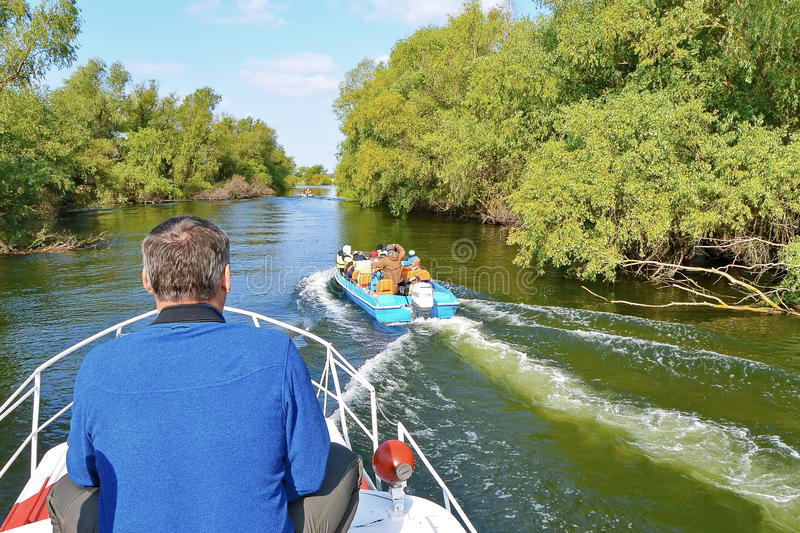 Visiting Danube Delta by boat stock images