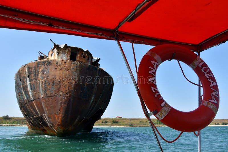 Visiting the famous abandoned shipwreck near Costinesti, Romania. COSTINESTI, ROMANIA - AUGUST 30, 2018. Boat trip with L`Ozana, visiting the famous abandoned royalty free stock photos